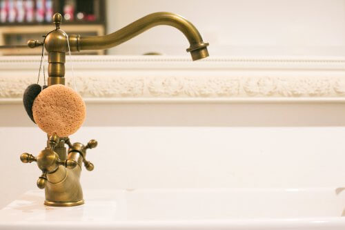 brass tap in a bathroom
