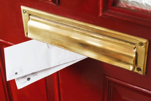 slightly tarnished brass letterbox