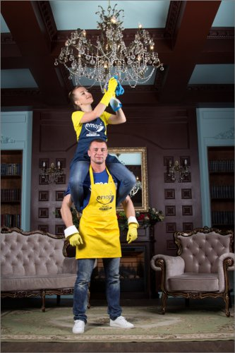 Professional cleaners cleaning Chandelier